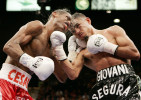 Cesar Canchila, of Columbia, left, exchanges blows with Giovani Segura during the 10th round of a WBA light flyweight championship boxing match at the MGM Grand Garden Arena in Las Vegas. Canchila won by unanimous decision.