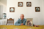 Edward Zajac, 94, sits with a photograph of his wife Agnes at this daughter's home in Henderson, Nevada. Upon his wife's death in 1981, he commissioned a statue of St. Ambrose, in her memory, which was erected at the St. Ambrose Catholic Church in Salt Lake City. The statue was recently stolen and soon recovered after the story ran.
