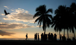 Teenagers socialize during sunset at Crash Boat Beach in Aguadilla, Puerto Rico.