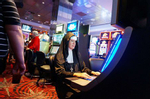 A woman from Texas dressed as a nun plays a slot machine on Halloween in downtown Las Vegas.