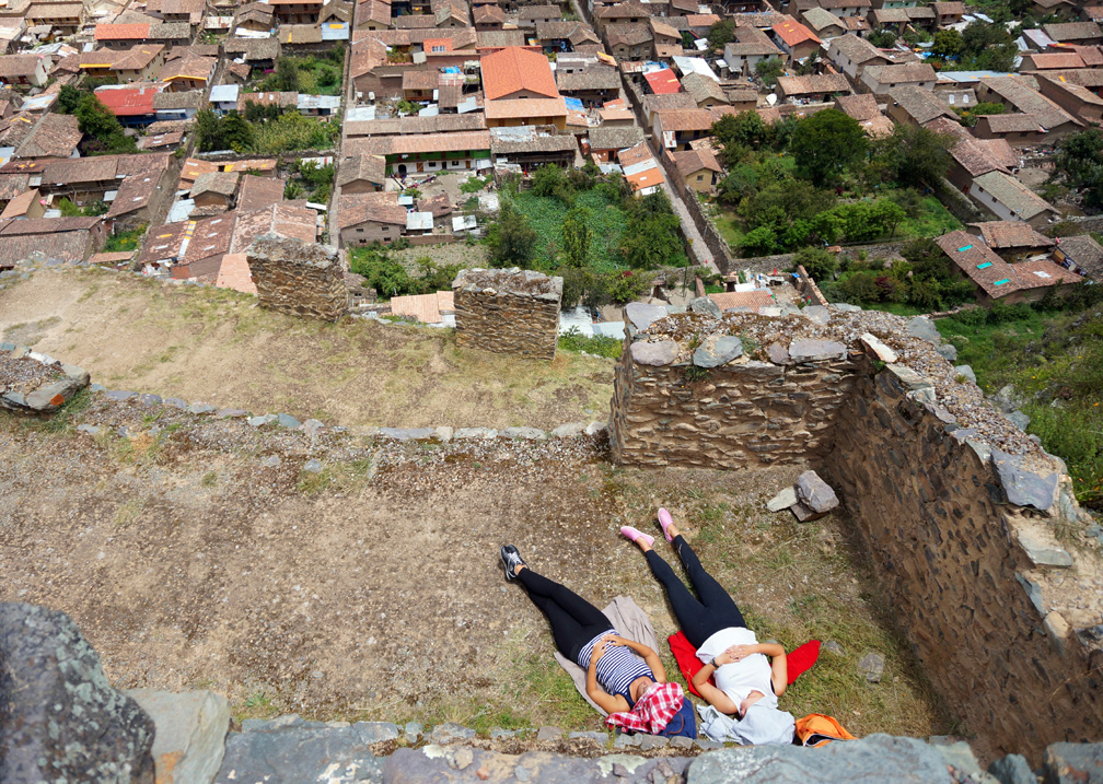 Woman sunbathe on the Pinkaylluna Incan ruins Wednesday, Feb. 19 2014, in Ollantaytambo, Peru.