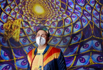 """Corvas Brinkerhoff, cofounder and executive creative director, stands in """"The Projected Desert"""" at Meow Wolf's Omega Mart on the interactive art exhibit's opening day."""