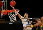 UC Santa Barbara's Miles Norris (5) goes for a shot past UC Irvine's Austin Johnson (13) during the second half of an NCAA college basketball game for the championship of the Big West Conference men's tournament.