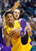 Los Angeles Lakers' Anthony Brown, front, grabs a rebound in front of Sacramento Kings' Kosta Koufos during the first half of an NBA preseason game in Las Vegas.