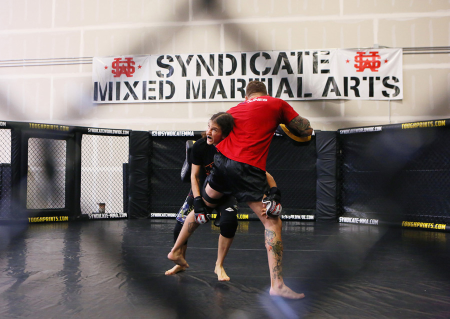 Mixed martial arts fighter Roxanne Modafferi, left, spars with her coach John Wood at Syndicate MMA Gym Wednesday, Aug. 27, 2014, in Las Vegas. Modafferi prepares for her upcoming all-female Invicta Fighting Championships flight scheduled for Sept. 6 in Kansas City, Mo