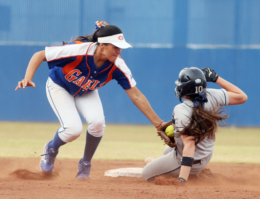 Bishop Gorman's Shelby Estocado, left, tags Centennial's Stephanie Day as Day steals second base during a game at Bishop Gorman High School Friday, April 25, 2014, in Las Vegas. Day was safe. Centennial won 10-4.