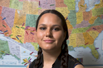 Rachael Cornelius '16 (Oneida) stands in front of a U.S. map with tabs showing the hometowns of Native students at Harvard. {quote}The Harvard University Native American Program has been my home away from home. I spent many nights working out chemistry equations on HUNAP's giant white board, overusing the coffee maker, and falling asleep on the sofa. Through both HUNAP and Native Americans at Harvard College, the community comes together as a family through dance, art, and food. I know the strong ties we made will not be undone by our graduation.{quote}Jon Chase/Harvard Staff Photographer