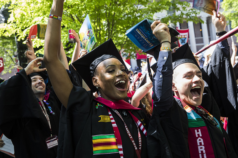HGSE grads Bree'Lynn Lombard and Edwin Parraga whoop it up as their degrees are conferred. Harvard University's 367th Commencement. Jon Chase/Harvard Staff Photographer