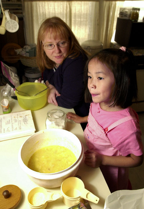 © 2010 Harvard University. Adoptive parent with her daughter, originally from China, at their home in Somerville, MA.