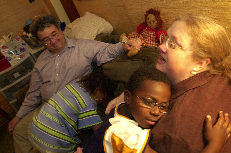 © 2010 Harvard University. Adoptive parents with their children at home in Somerville, MA.