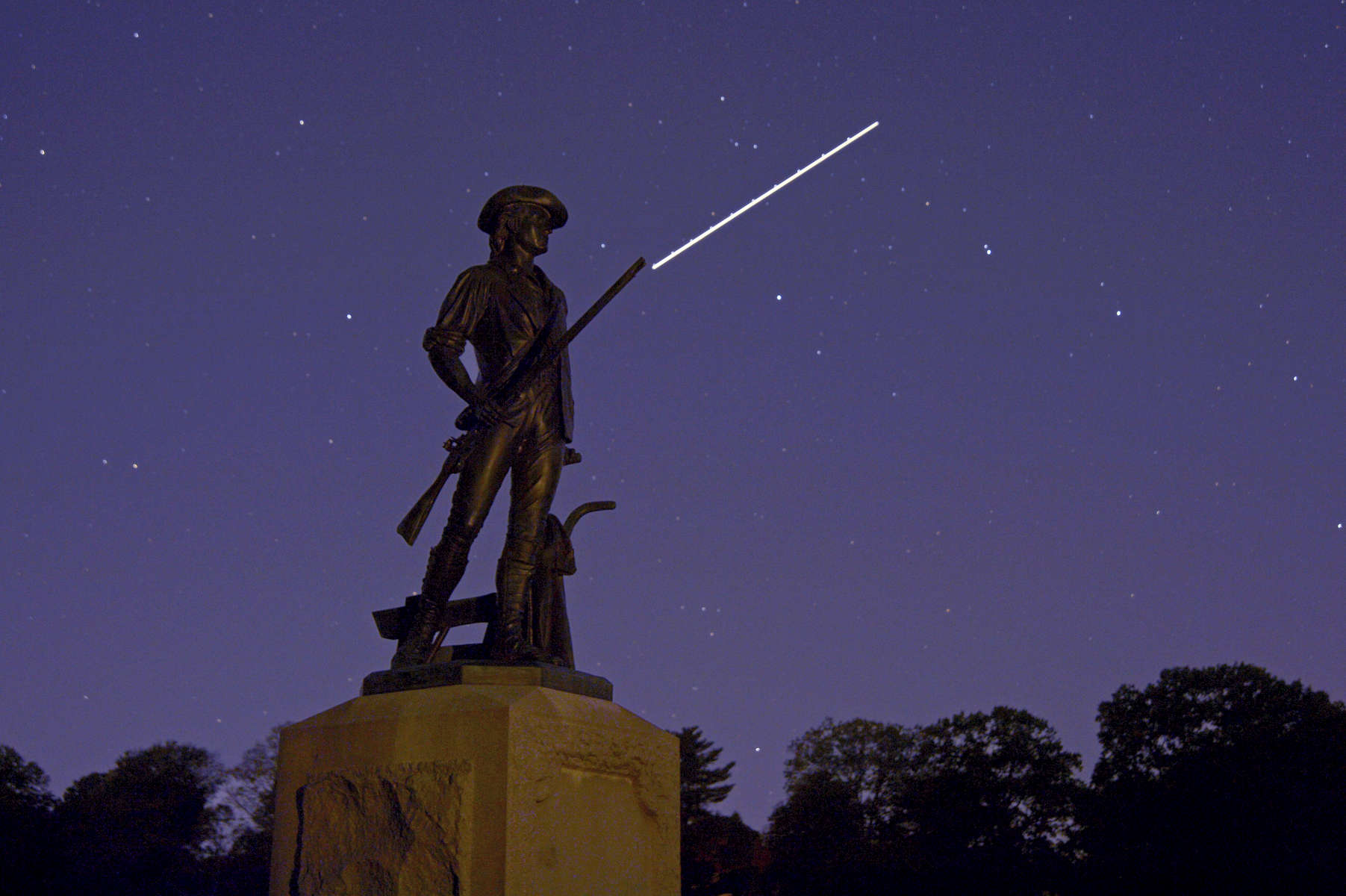 Old North Bridge and Minuteman statue in Concord, MA.Jon Chase photo