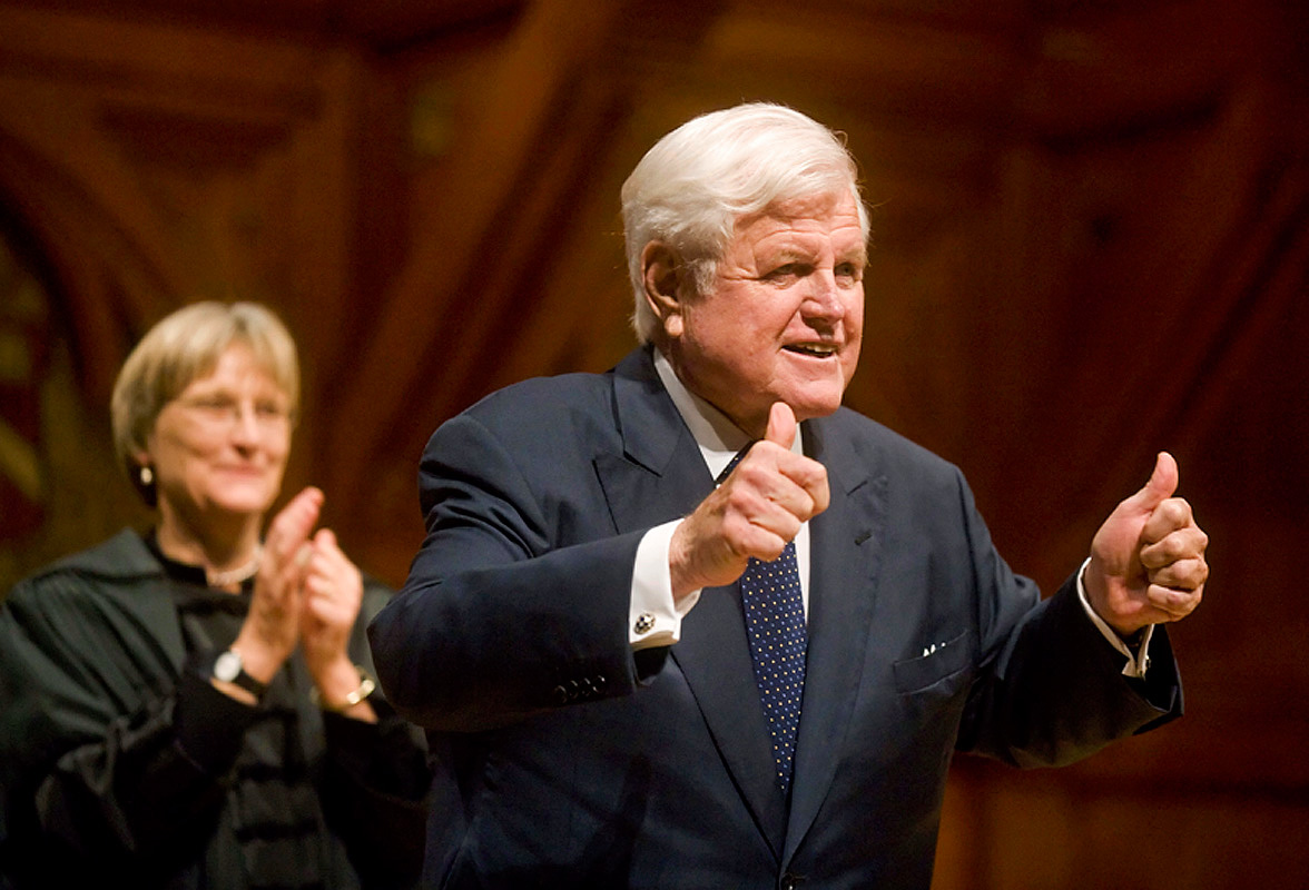 © 2010 Harvard University. Sen. Ted Kennedy gives an enthusiastic thumbs-up as Harvard President Drew Faust applauds, after he received an honorary degree at a special Harvard convocation in December. Kennedy was unable to receive his degree the previous June because he was being treated for a malignant brain tumor.