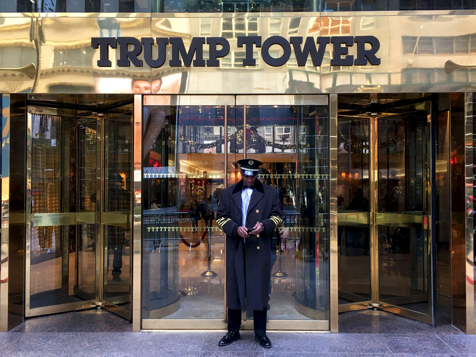 Doorman at front entrance to Trump Tower. Jon Chase photo