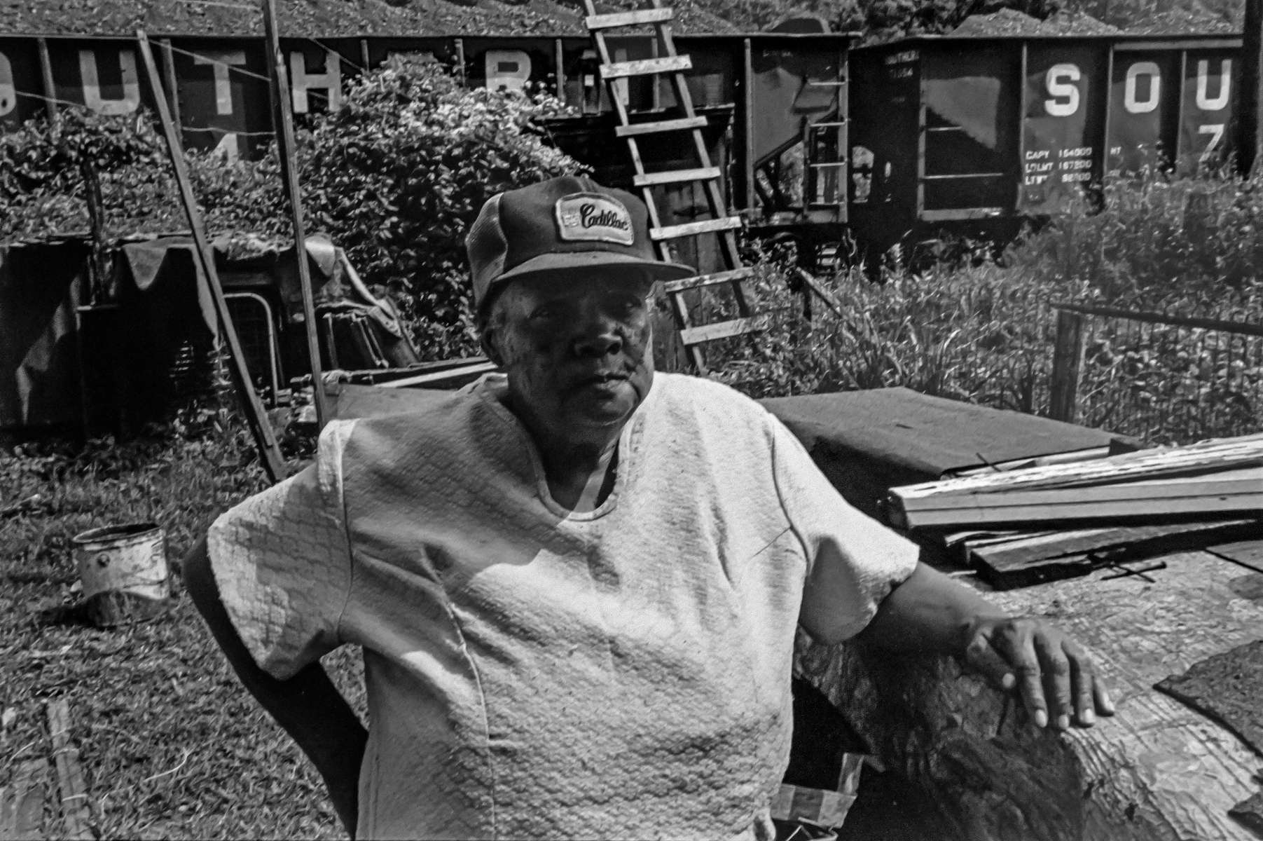 Woman wearing a Cadillac hat in her yard in an all-Black, back hills hollow in West Virginia, 1978. Jon Chase photo