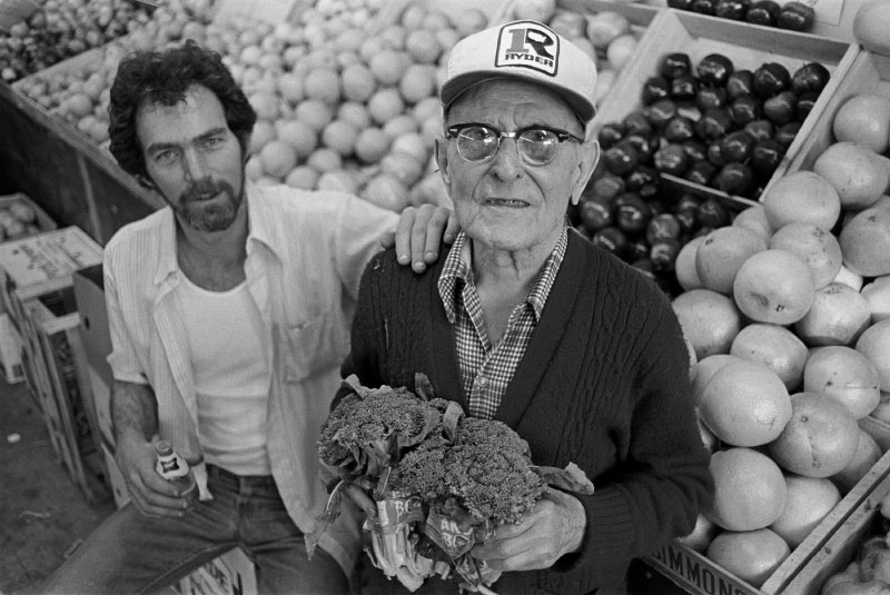 Bobby Comeau, owner of Bobby's Fruit, with his right-hand man, ninety-year old Louis Picariello. {quote}Working here keeps me active, keeps my legs moving. At home, I'd just sit and nap, or smoke my cigar. Here at the store, everybody knows my name. And working with Bobby...he's like a grandson. You know, I enjoy it more here  than at home. But don't tell my wife!{quote}Louis Picariello