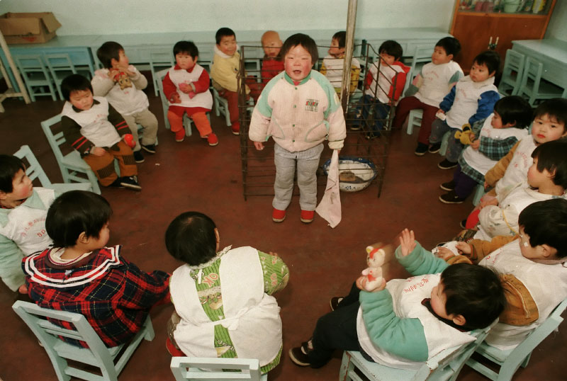 Young children play a game at the Children's Welfare Institute in Hefei.