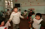 Young children who are probably too old to be adopted by parents wanting infants, at the Children's Welfare Institute in Hefei.