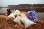China_flood_couple_bags