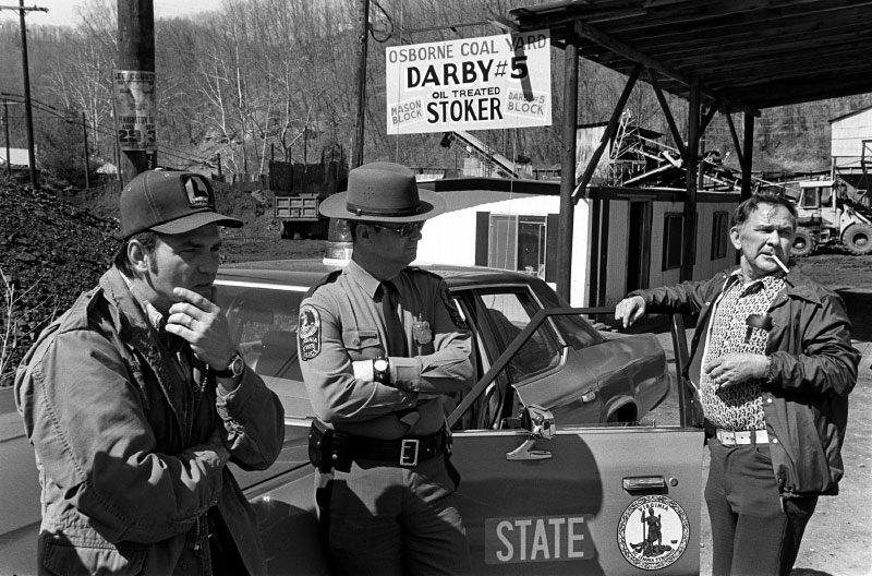 Miners pass the time with a state trooper during coal strike.
