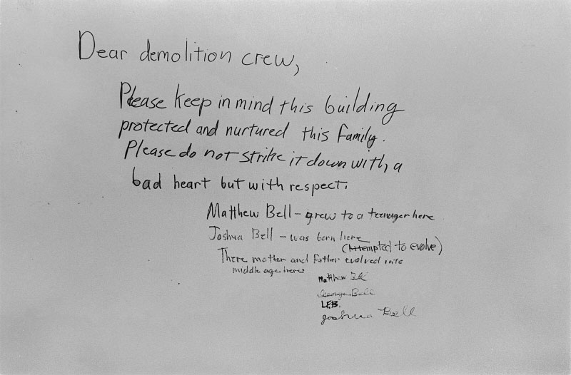 Poignant memo scrawled on a wall for the demolition crew after a neighborhood farewell party.