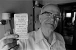 Tenant John McDonald with his 1923 pass to the Newton Opera House, where he worked for forty-four years until it was demolished.
