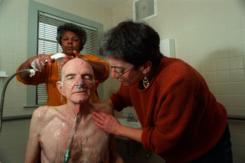 Louis, an emphysema patient, is given a shower.
