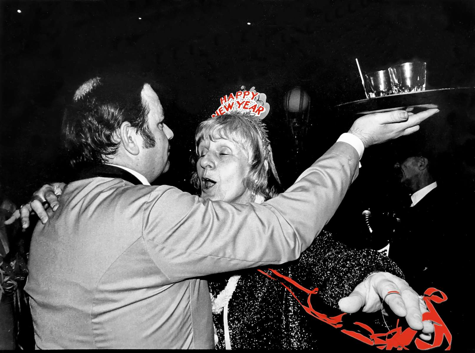 The last New Year's Eve celebration ever at the Marlboro-Blenheim Hotel, Atlantic City, in 1977, before the historic structure was demolished the following fall. When it was built in 1902-1906, the Marlboro-Blenheim was the largest reinforced concrete building in the world. Most of the people present on this night were devoted guests who returned year after year to celebrate with decades-old friends. Thanks to fellow photographer and good friend Roz Gerstein, who accompanied me and generated the idea for this photo expedition. Jon Chase photo