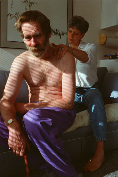 Mick, a young man with AIDS, receives a massage from Debra, a nurse.