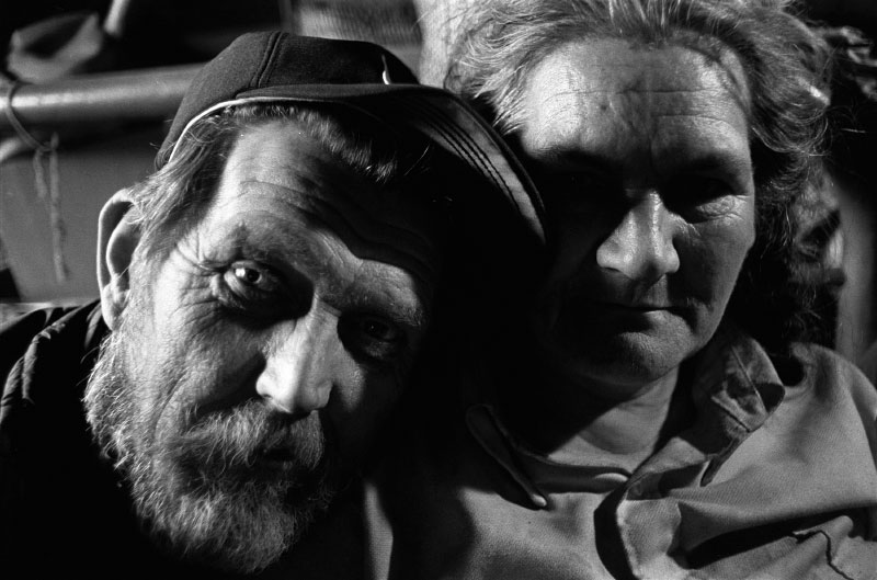 Disabled coalminer and wife, Harlan, Ky. Shortly after this photo was taken, the man trained a rifle on his wife, threatened to kill her, and fired several shots into the wall of his one-room cabin.