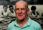 © 2010 Harvard University. Harry  Parker, in his 40th year as Harvard men's crew coach, stands by a photo of the 1974 heavyweight crew that went undefeated for 4 consecutive years.
