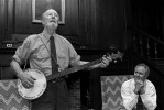 © 2010 Harvard University. Legendary folksinger Pete Seeger performs a song as actor John Lithgow watches.