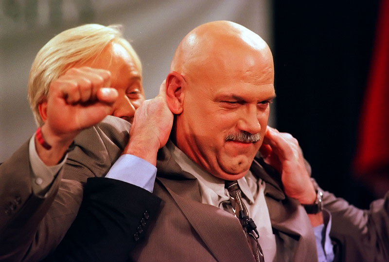 © 2010 Harvard University. MSNBC host Chris Matthews attempts to put a headlock on former pro wrestler and Minnesota Governor Jesse Ventura during a break in filming the TV show {quote}Hardball{quote}.