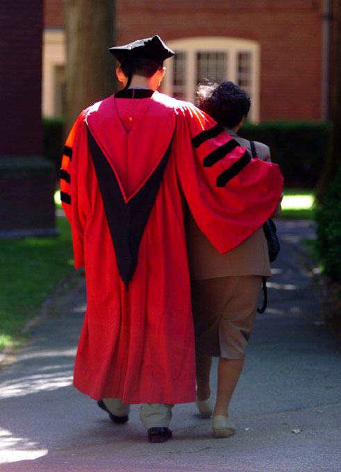 © 2010 Harvard University. Harvard graduate leaving Commencement ceremonies with his mother.