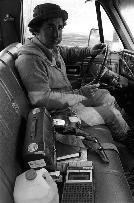 Mine supervisor driving to check on mine during strike, Norton, Va. The pistol on the seat, as well as two rifles under the seat, were for protection in case anyone fired shots at his truck, thinking he was a scab going to work.