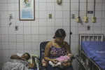 JANUARY 8, 2016 -- Cleane Silva, 18, holds one-month-old Duda who was born with zika-related microcephaly, at the University Hospital of Oswaldo Cruz where the newborn recovers from severe malnutrition, in Recife. Cleane's mother-in-law, Mirian Pereira, became guardian of Duda when the baby was abondoned at birth by her brother and his wife at the maternity hospital.