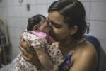 JANUARY 8, 2016 -- Cleane Silva, 18, holds Duda at the University Hospital of Oswaldo Cruz. Cleane and Mirian rescued the newborn who was abandoned at birth by her brother and his wife at the maternity hospital.