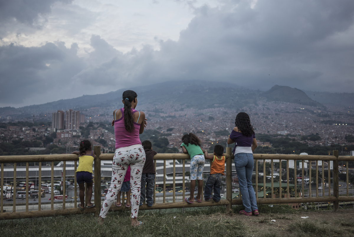 Residents take in the view at the top of the {quote}hill{quote}, the area of a new garden. Since 2012, the city of Medellin began an innovative project in the neighbourhood of Moravia to transform the city's main garbage dump into a sustainable garden where 50 thousands residents lived.