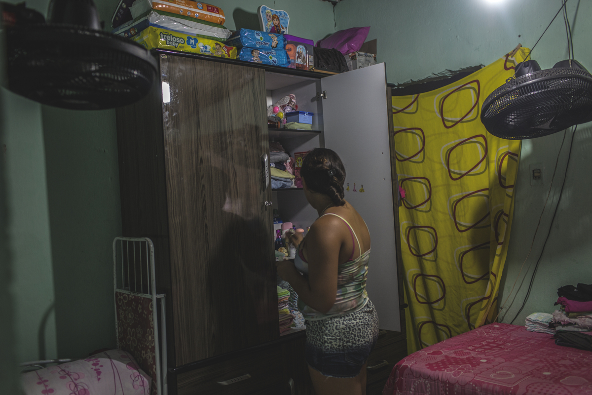 JANUARY 9, 2016 -- Mirian and Cleane live in this one-bedroom house in Olinda, 30 min north of Recife, with Mirian's son. The closet is stocked with clothes, diapers and baby care - donations given by individuals who heard of Duda's story in the local media.