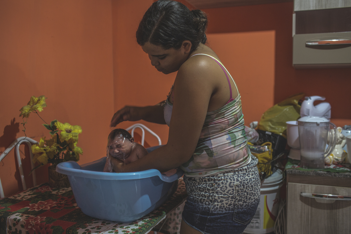 JANUARY 9, 2016 -- Cleane bathes Duda, her second-day at home from the hospital. Water is soothing for most Zika babies, and calms their incessant crying.
