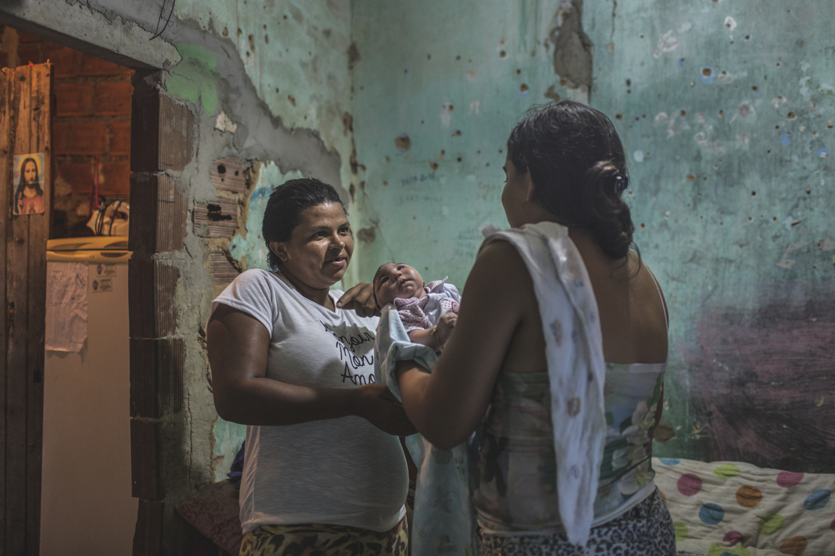 JANUARY 9, 2016 -- Cleane brings Duda over meet the baby's biological mother, Maria Rodrigues, 29, who abandoned Duda at the maternity hospital because she couldn't care for her daughter, in their tiny one-room home, in Olinda. Both Maria and her husband, who are recyclers, suffer from a mental disorder and alcoholism.