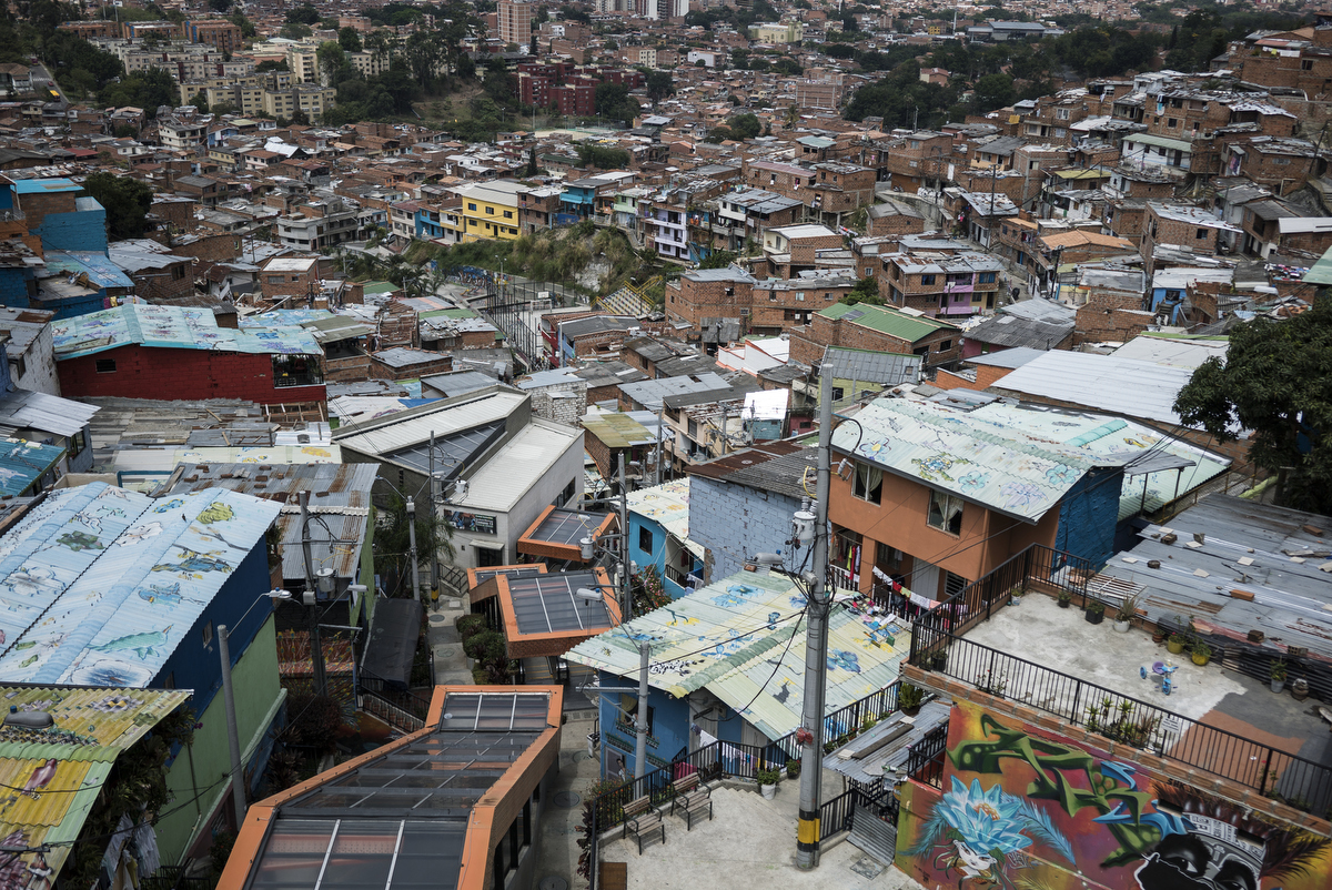 The 384-metre-long escalator in Comuna 13, the most dangerous district in Medellin, Colombia. In 2006, the city built a public library, a new school, public green spaces, and improved access to transportation through a cable car line and escalators connecting the neighbourhoods to the metro and the city.