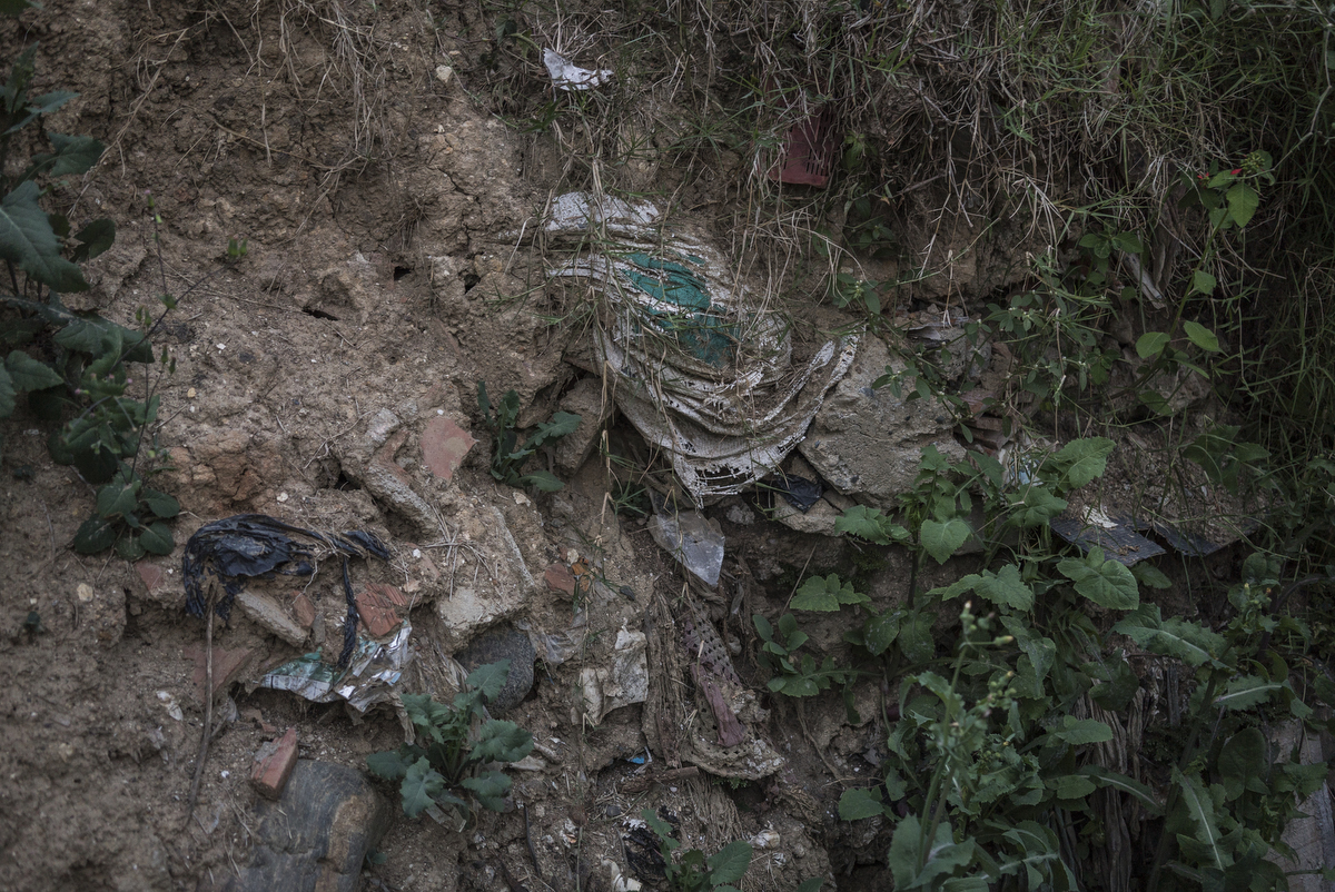 Layers of trash is still visible in the former garbage dump turned garden. Since 2012, the city of Medellin began an innovative project in the neighbourhood of Moravia to transform the city's main garbage dump into a sustainable garden.
