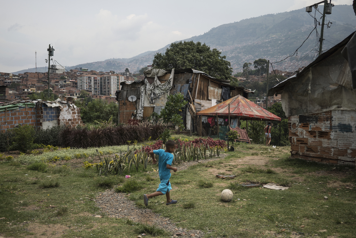 One of the remaining families on the {quote}hill{quote}, the site of a new garden. Since 2012, the city of Medellin began an innovative project in the neighbourhood of Moravia to transform the city's main garbage dump into a sustainable garden.