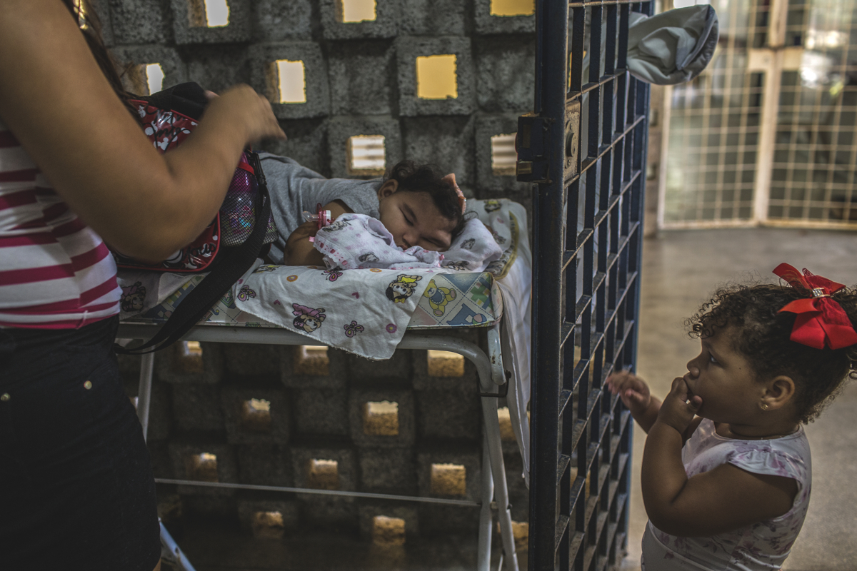 MARCH 15, 2017 -- Miriam and Cleane wait for Duda's physical therapy session at Oswaldo Cruz University Hospital, in Recife. They arrive early to be the first in line to meet with therapists. During this time, they catch up with other mothers who have children with zika-related microcephaly, and share their knowledge and discoveries as their babies encounter changing health issues. They talk about the latest concerning issue now, hydrocephaly - when there's too much water in the brain.
