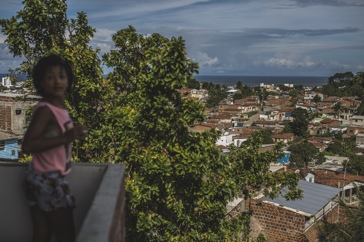 MARCH 15, 2017 -- A view of Olinda and the ocean from the second level of their home, on Wednesday, March 15, 2017. A local community politician decided to help her family build additional rooms upstairs and is nearly finished. The rooms have light and breeze that comes off the ocean, unlike downstairs where there is little ventilation.