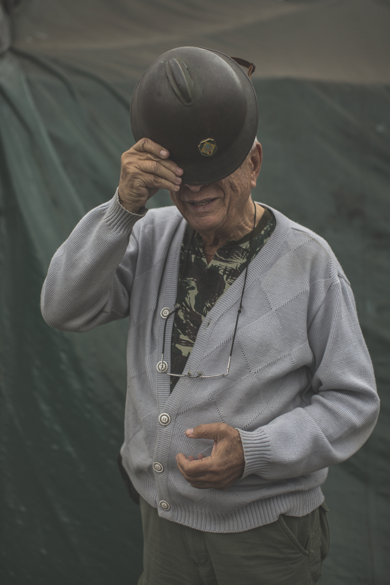 Retired sheriff Alberto Augusto, 72, of the Brazilian Interventionist Resistence Movement (MBRI), wears his grandfather's helmet from 1932, at their headquarters.