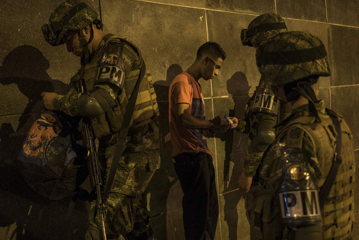 The Colombian army patrols in Comuna 8, in Medellin, Colombia. The patrol was set up by the communications department to show public security in the city. Although they frequently patrol unannounced in neighbourhoods and usually target specific drug traffickers based on intelligence information, this event highlighted the army spending their resources on frisking young men and raiding party spots for small amounts of marijuana.