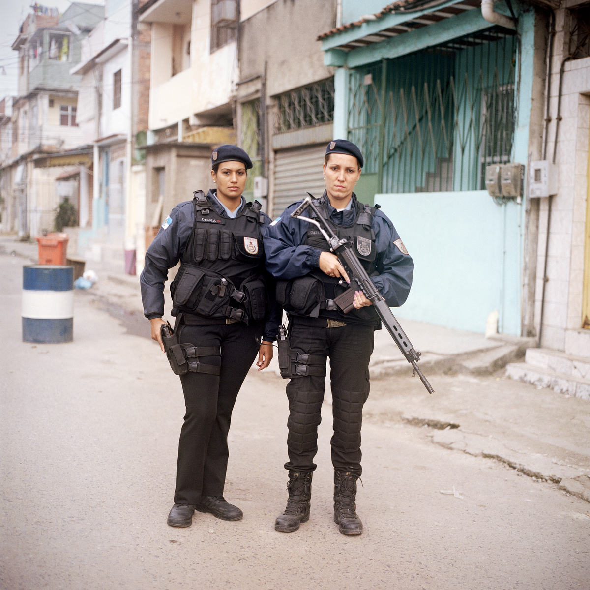 Patrol Officers Dilma Carvalho, 32, left, and Carla Bonn, 33, right, are with the Rapid Response Team of the Pacifying Police Unit (UPP), in Complexo do Caju, Rio de Janeiro, Brazil.