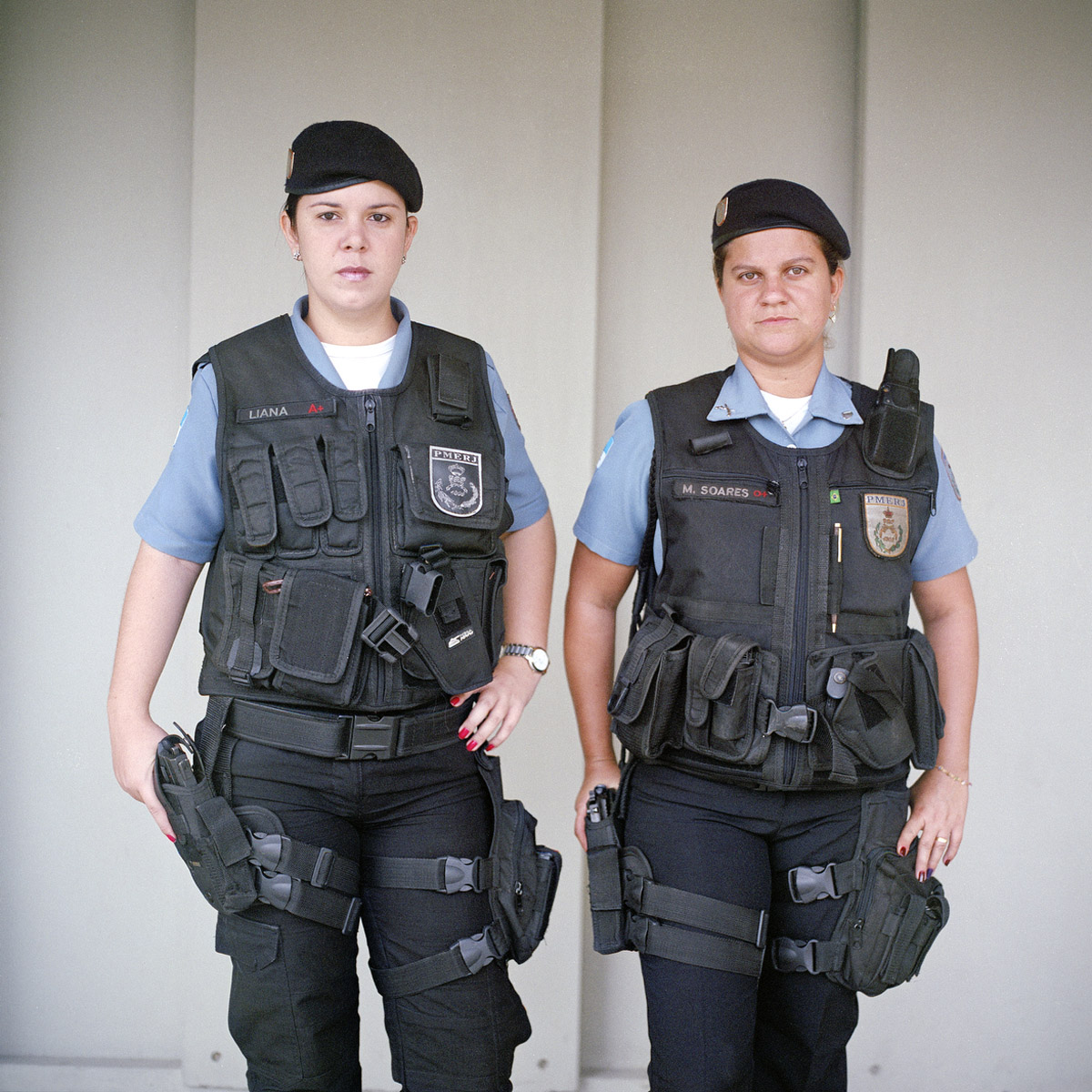 Patrol officers Liana Brum, 29, left, and Michelle Soares, 27, right, with the Rapid Response Team of the Pacifying Police Unit (UPP), in Complexo do Caju, Rio de Janeiro, Brazil.