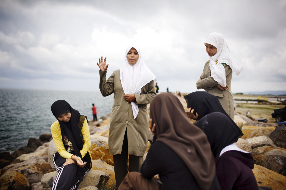 Sharia policewomen lecture university students on proper Muslim attire, in Ulele, Indonesia, on Wednesday, Nov. 11, 2009. In 2003, the provincial government of Aceh Province implemented a moderate form of sharia law on conduct and dress in their effort to reclaim Aceh as the Islamic capital of SE Asia.